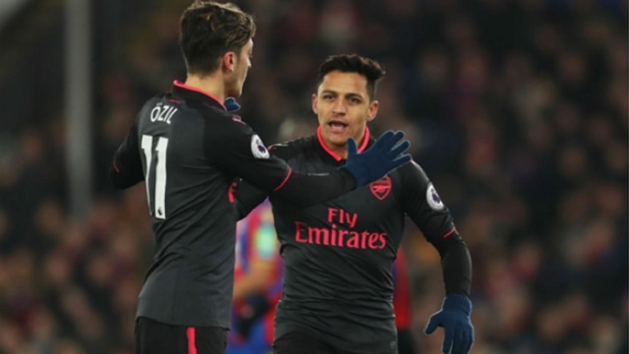 Arsenal stars Mesut Ozil and Alexis Sanchez.