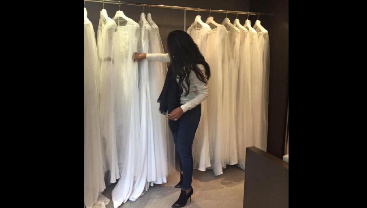 Lisa Hanna shared a photo of herself on social media looking at wedding gowns.
