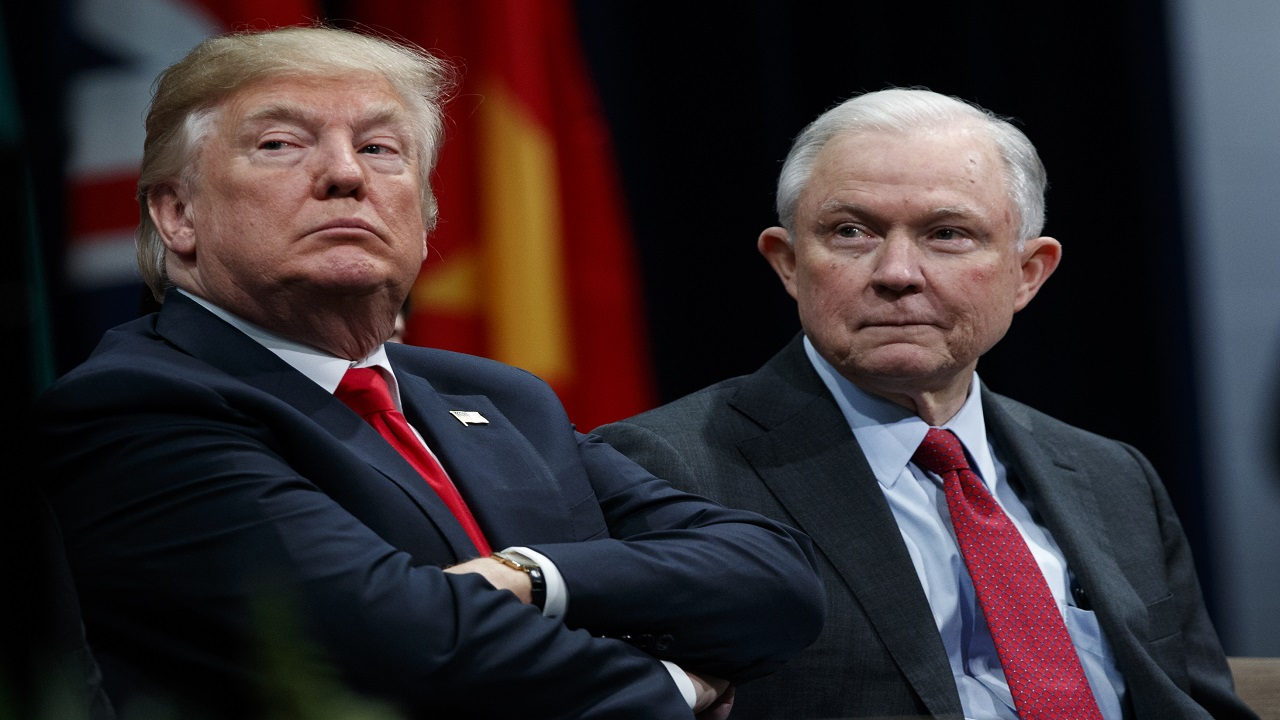 In this Dec. 15, 2017, file photo, President Donald Trump sits with Attorney General Jeff Sessions during the FBI National Academy graduation ceremony in Quantico, Va. Trump's White House counsel personally lobbied Attorney General Jeff Sessions to not recuse himself from the Justice Department's investigation into potential ties between Russia and the Trump campaign.
