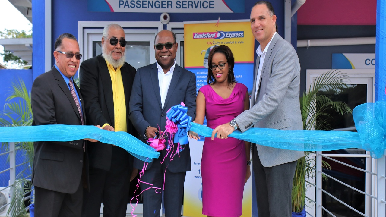 Anthony Copeland (Executive Director of Knutsford Express Services Limited), Gordon Townsend (Chairman of Knutsford Express Services Limited), Minister of Tourism Edmund Bartlett, T'shura Gibbs (President of the Montego Bay Chamber of Commerce and Oliver Townsend (CEO and Director of Knutsford Express Services Limited).
