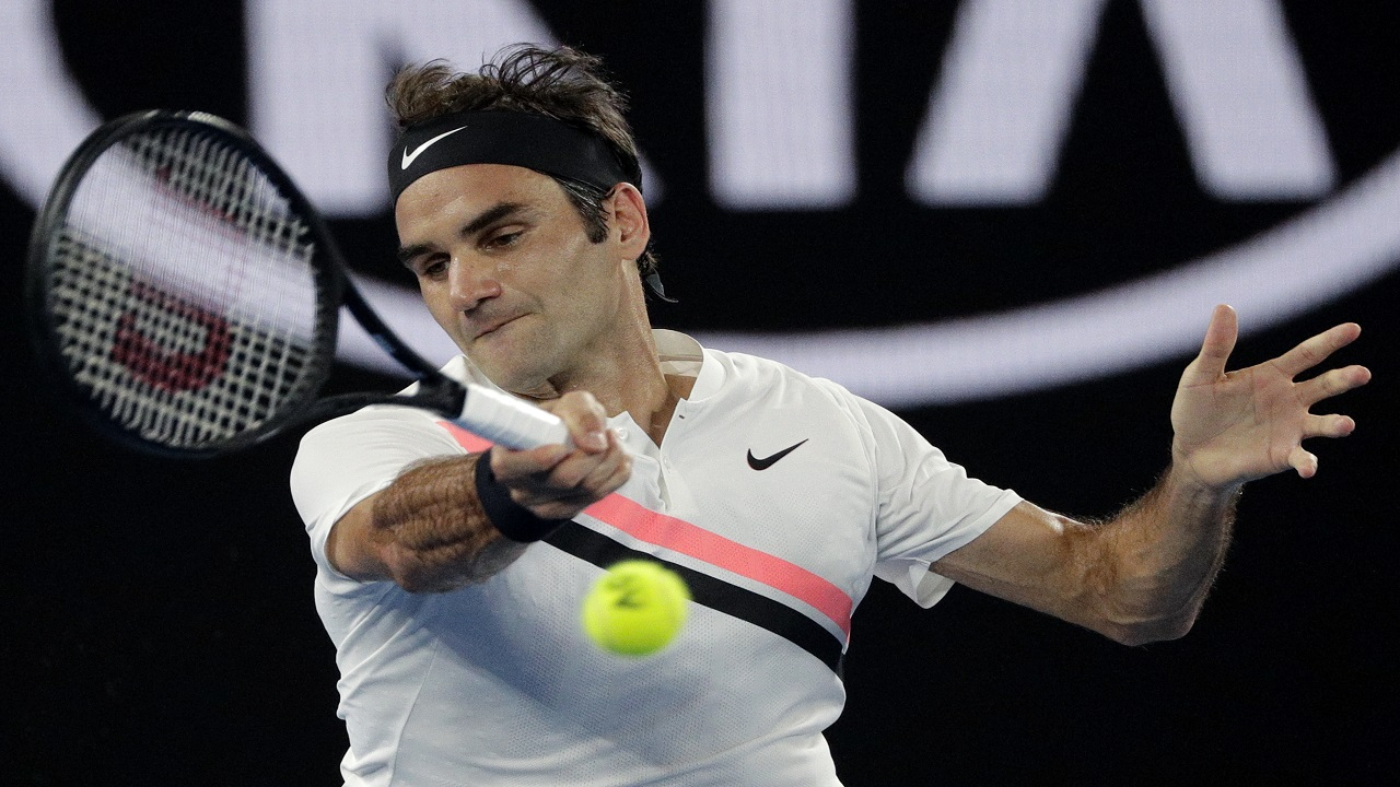 Switzerland's Roger Federer makes a forehand return to South Korea's Hyeon Chung during their semifinal at the Australian Open tennis championships in Melbourne, Australia, Friday, Jan. 26, 2018.