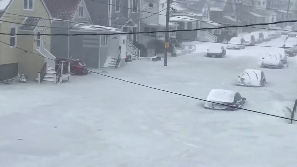 WATCH: Cars trapped in frozen floodwater during winter 'bomb