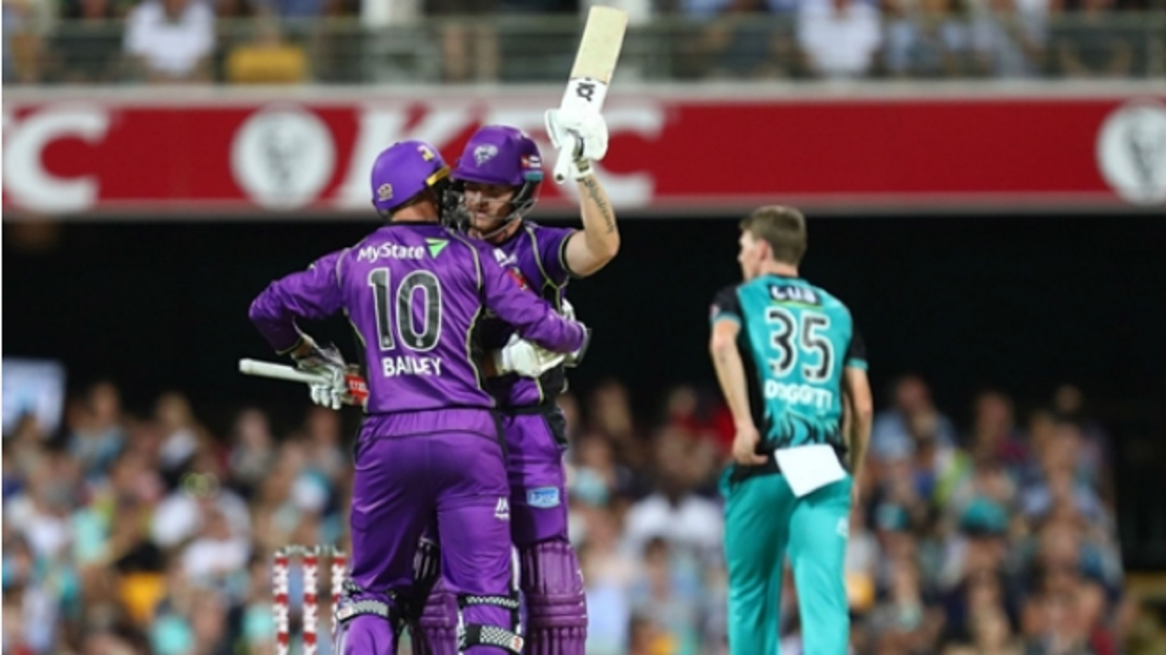 Hobart Hurricanes batsman D'Arcy Short celebrates his record-breaking hundred.
