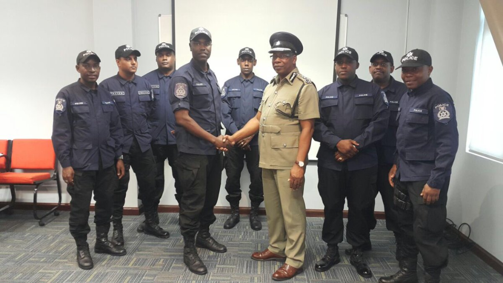 The officers are Sgt Pitt (shaking the hand of Acting Police Commissioner Stephen Williams) ;Cpl Pamphille and PCs Williams; Coombs; Simon; Baboolal; Bernard and Gomez.