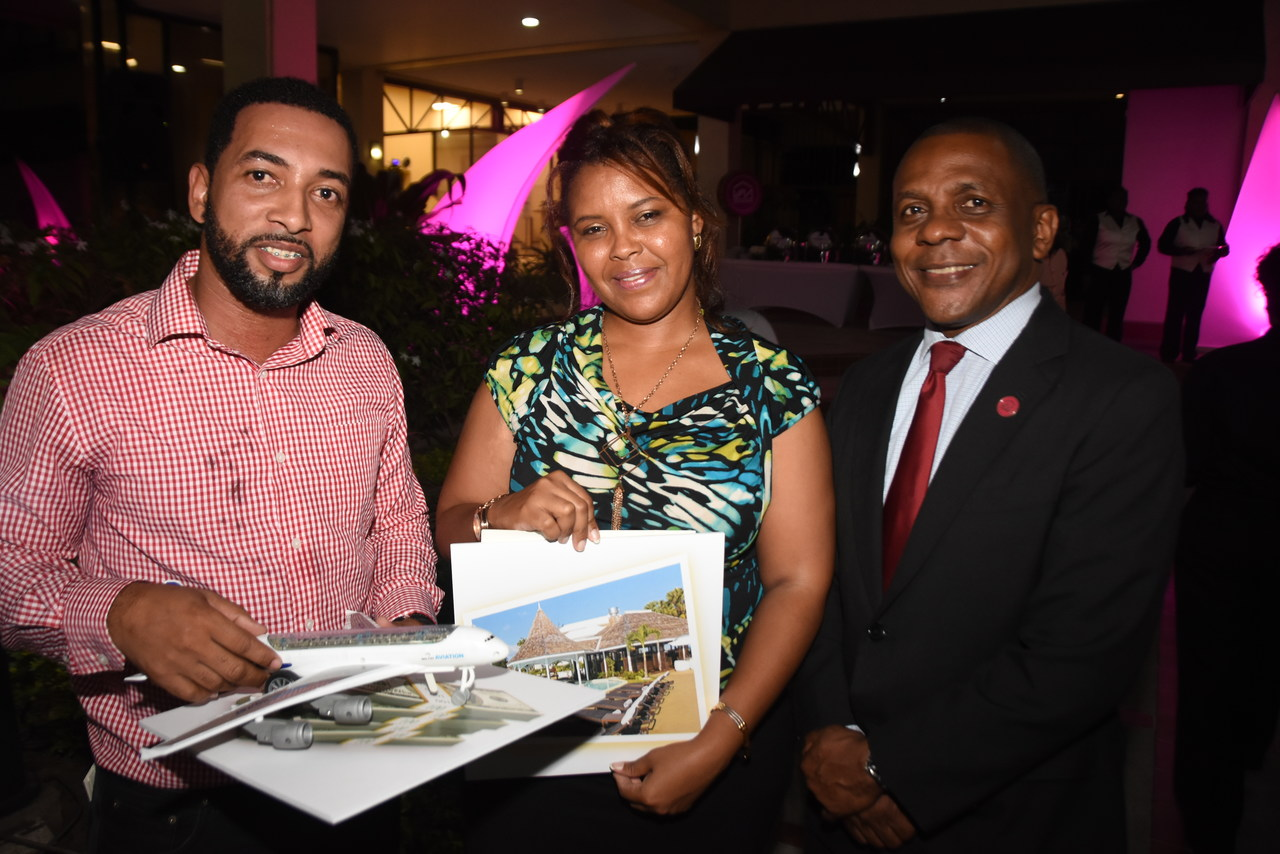 Courtney Campbell, President & CEO, Victoria Mutual celebrates with Miguel