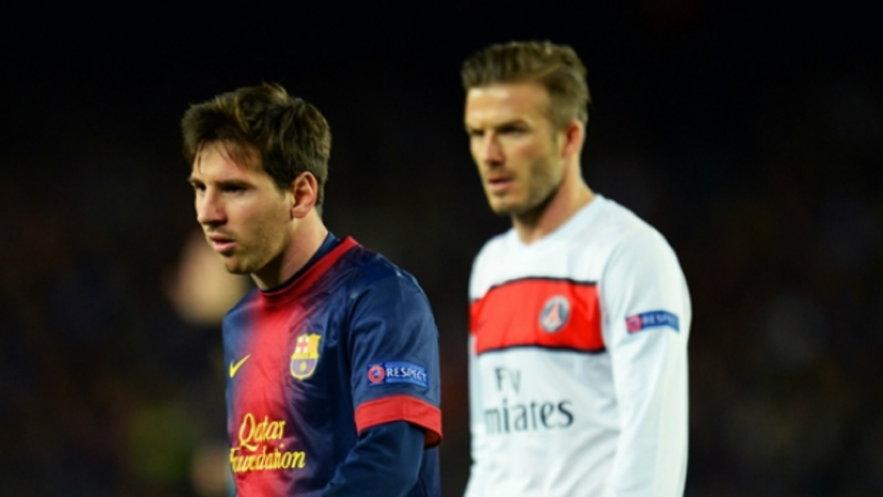 Lionel Messi (left) and David Beckham competing in a Champions League match in 2013.