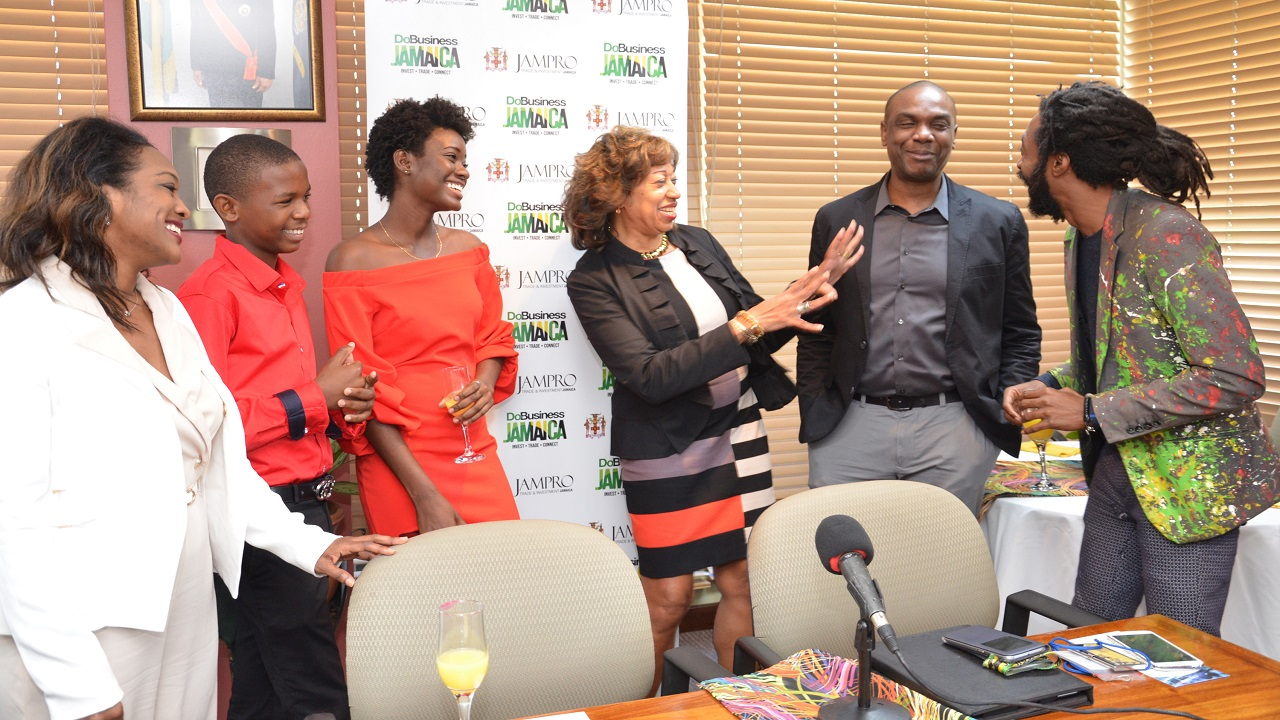 JAMPRO President Diane Edwards (centre) shares a story with (L-R) Renee Robinson, Film Commissioner; Antwayne Eccleston, Actor; Shantol Jackson, Actress; Claude Duncan, Vice President of Sales and Promotions, JAMPRO, and Everaldo Creary, Actor at JAMPRO's pre-festival send off for the Yardie film premiere.