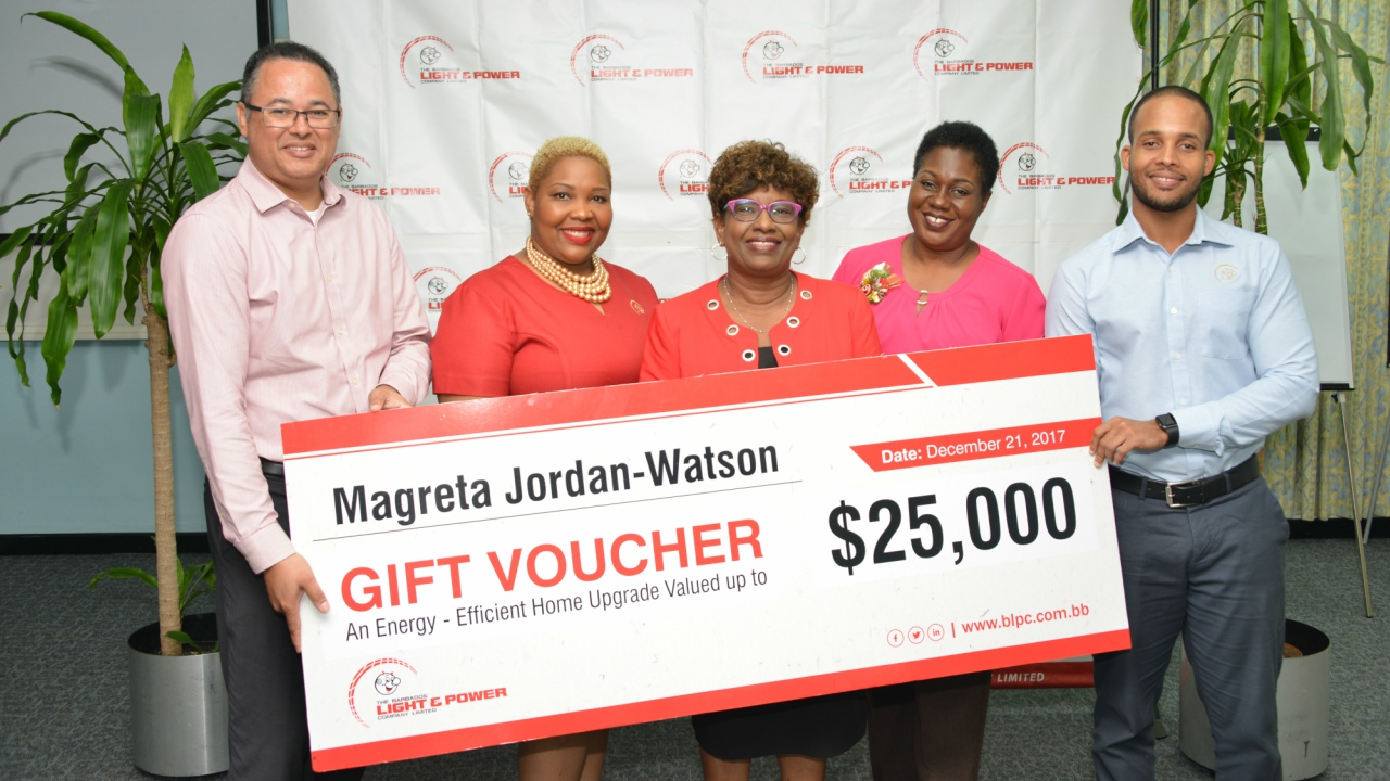 From left: MD Roger Blackman, Director Customer Solutions Kim Griffith-Tang How, along with Manager Communications and Government Relations Jackie Marshall-Clarke and Market Analyst Justin Carter presented Magreta (centre) with her voucher.