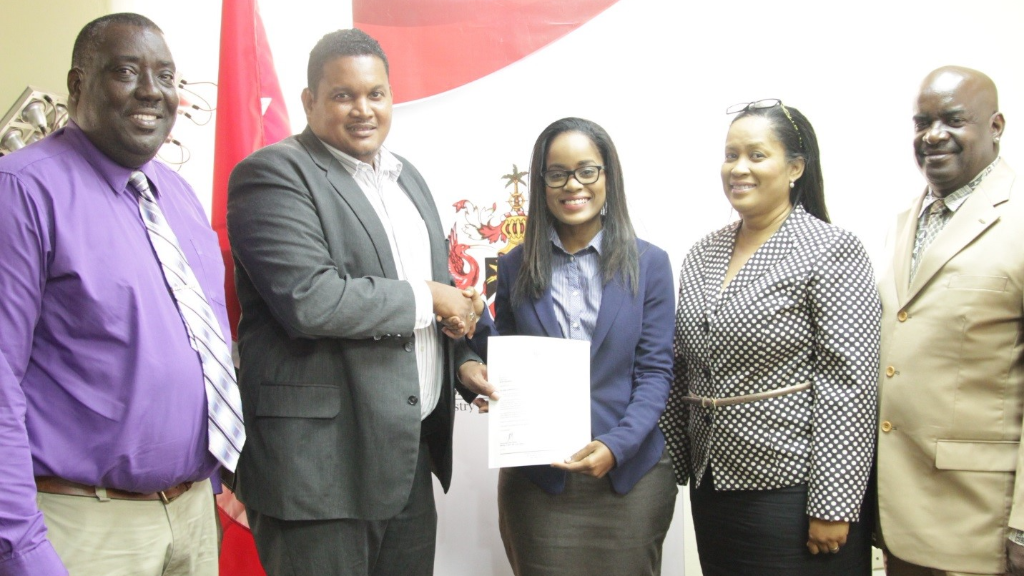 Darryl Smith, Minister of Sport and Youth Affairs, presents Ms. Terez Lord with Letter of Appointment.