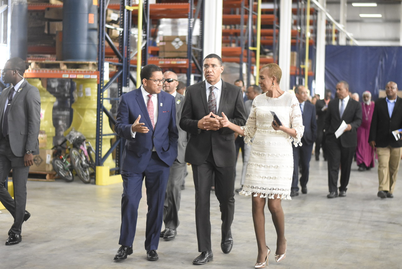 Kingston Wharves CEO Grantley Stephenson  (left) in discussion with Prime Minister Andrew Holness (centre) and Fayval Williams, Minister of State for Finance and Public Service during a tour of the new Total Logistics Facility.