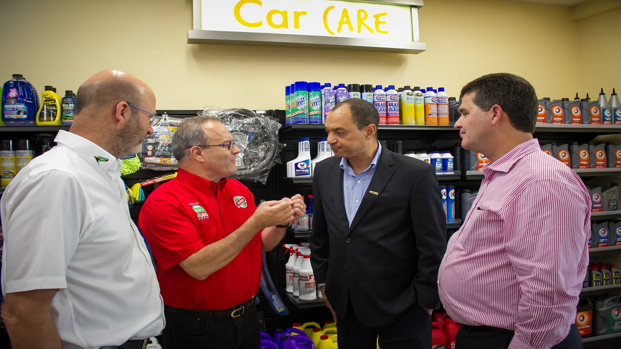 RUBiS Energy Jamaica CEO Alain Carreau (second left) makes a point in discussion with (from left) Duncan Stewart, Director of Automotive Art; Group CEO of GraceKennedy Don Wehby, and Chairman of Wisynco Group William Mahfood at the grand opening of the RUBiS Ultra Shop in Kingston on Thursday November 30, 2017.