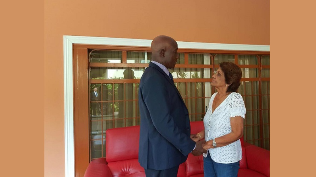 Prime Minister Dr Keith Rowley greets the wife of former President George Maxwell Richards, Dr Jean Ramjohn-Richards.