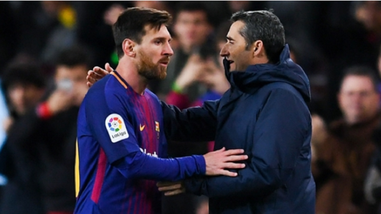 Barcelona star Lionel Messi (left) and head coach Ernesto Valverde.