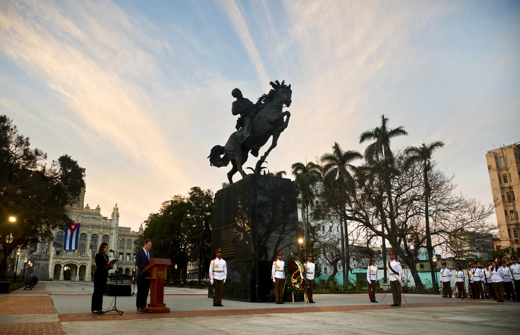 People attend a ceremony to unveil a replica of a New York statue of Cuba's independence hero Jose Marti in Havana, Cuba, Sunday, Jan. 28, 2018. The monument was unveiled on the 165th anniversary of the birth of the Cuban independence hero. (AP Photo/Ramon Espinosa)