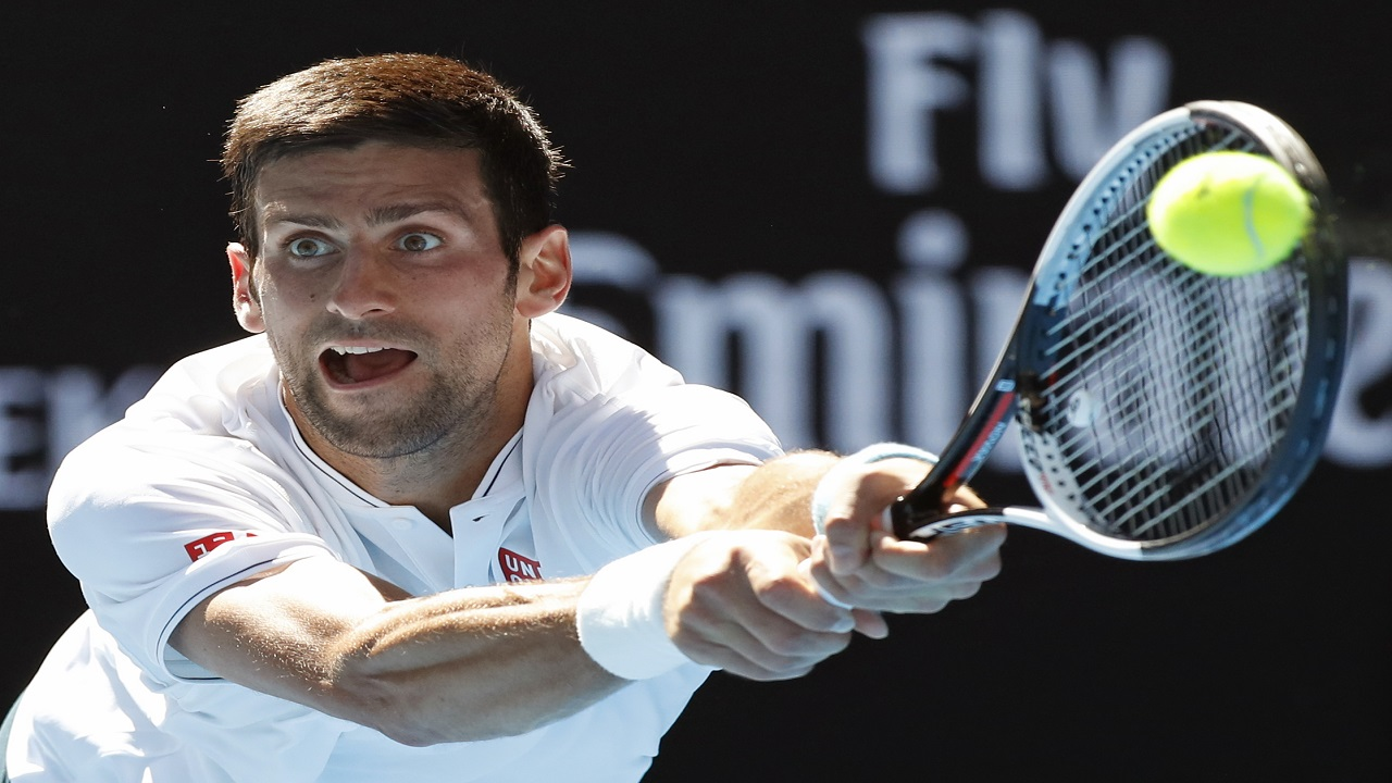 In this Jan. 19, 2017, file photo, Serbia's Novak Djokovic makes a backhand return to Uzbekistan's Denis Istomin during their second round match at the Australian Open tennis championships in Melbourne, Australia. Dkokovic is still not sure whether he will be able to play in the 2018 Australian Open.