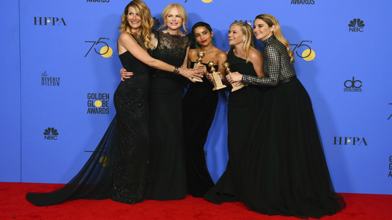 "Laura Dern, from left, Nicole Kidman, Zoe Kravitz, Reese Witherspoon and Shailene Woodley pose in the press room with the award for best television limited series or motion picture made for television for ""Big Little Lies"" at the 75th annual Golden Globe Awards. (Photo by Jordan Strauss/Invision/AP)"