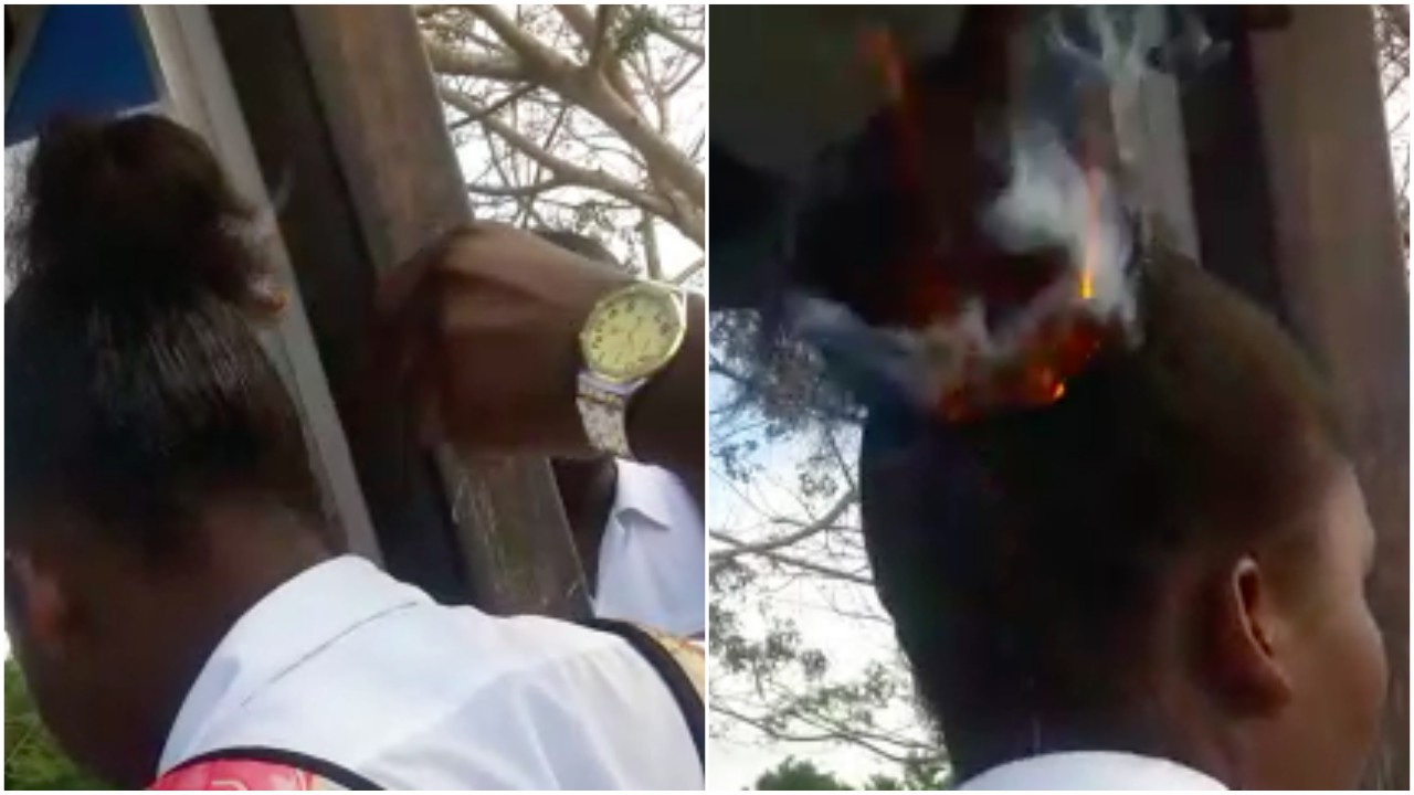 Photos of the girls hair being set on fire and ablaze from the video.