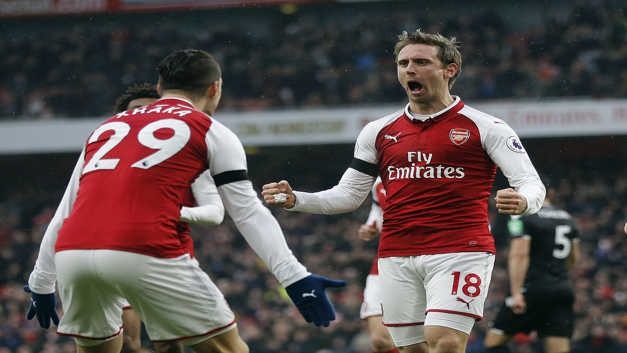 Arsenal's Nacho Monreal, center, celebrates with teammates after scoring his side's first goal during the English Premier League football game against Crystal Palace at the Emirates stadium in London, Saturday, Jan. 20, 2018.