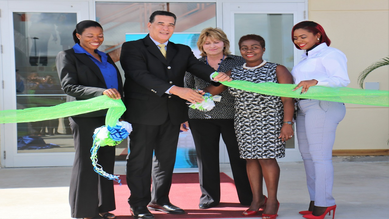 (From left) Marie Whyte (site director, ACT); Mayor of Montego Bay Homer Davis; Suzan Parker (Executive Vice President, ACT); Gloria Henry (President BPIAJ); and Yanique McKenzie (ACT Director of Operations) at the ribbon cutting ceremony.