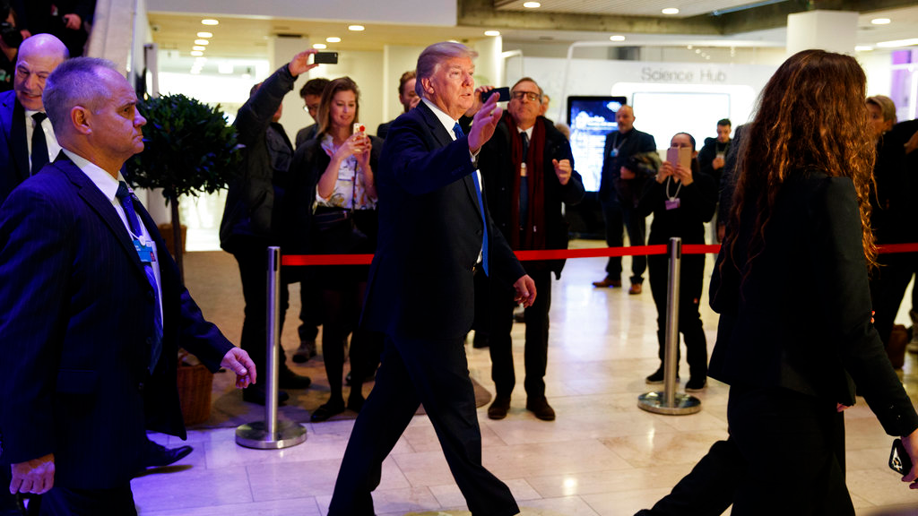 President Donald Trump waves as he walks to a dinner with European business leaders at the World Economic Forum, Thursday, January 25, 2018, in Davos. (AP Photo/Evan Vucci)