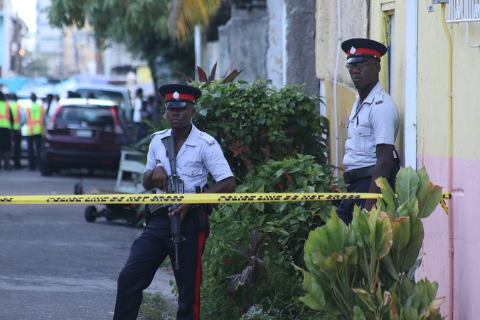 File photo of two police officers at a crime scene in downtown Kingston