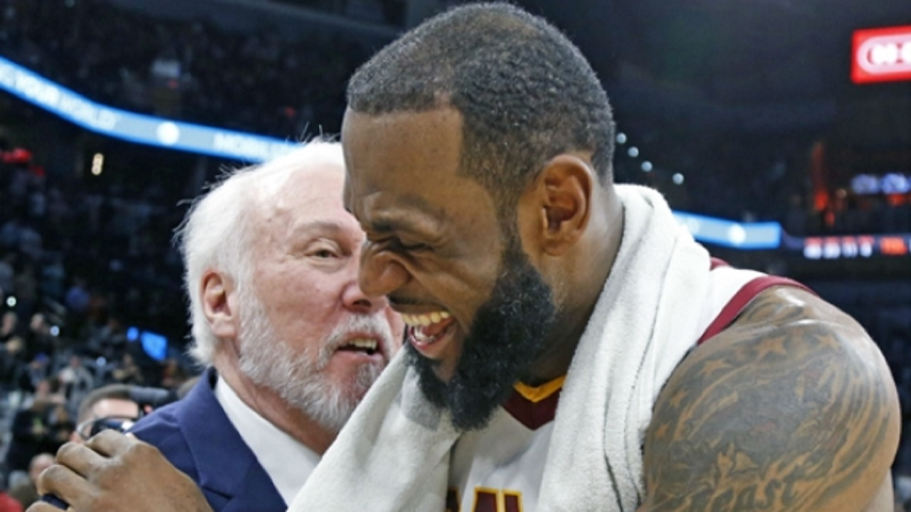 San Antonio Spurs head coach Gregg Popovich (left) shares a light moment with Cleveland Cavaliers star LeBron James.