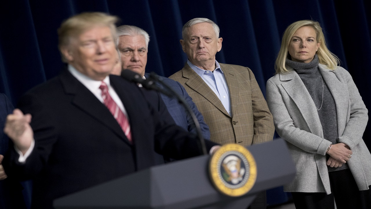 From left, President Donald Trump, accompanied by Secretary of State Rex Tillerson, Defense Secretary Jim Mattis, and Secretary of Homeland Security Kirstjen Nielsen, speaks to members of the media after participating in a Congressional Republican Leadership Retreat at Camp David, Md., Saturday, Jan. 6, 2018.