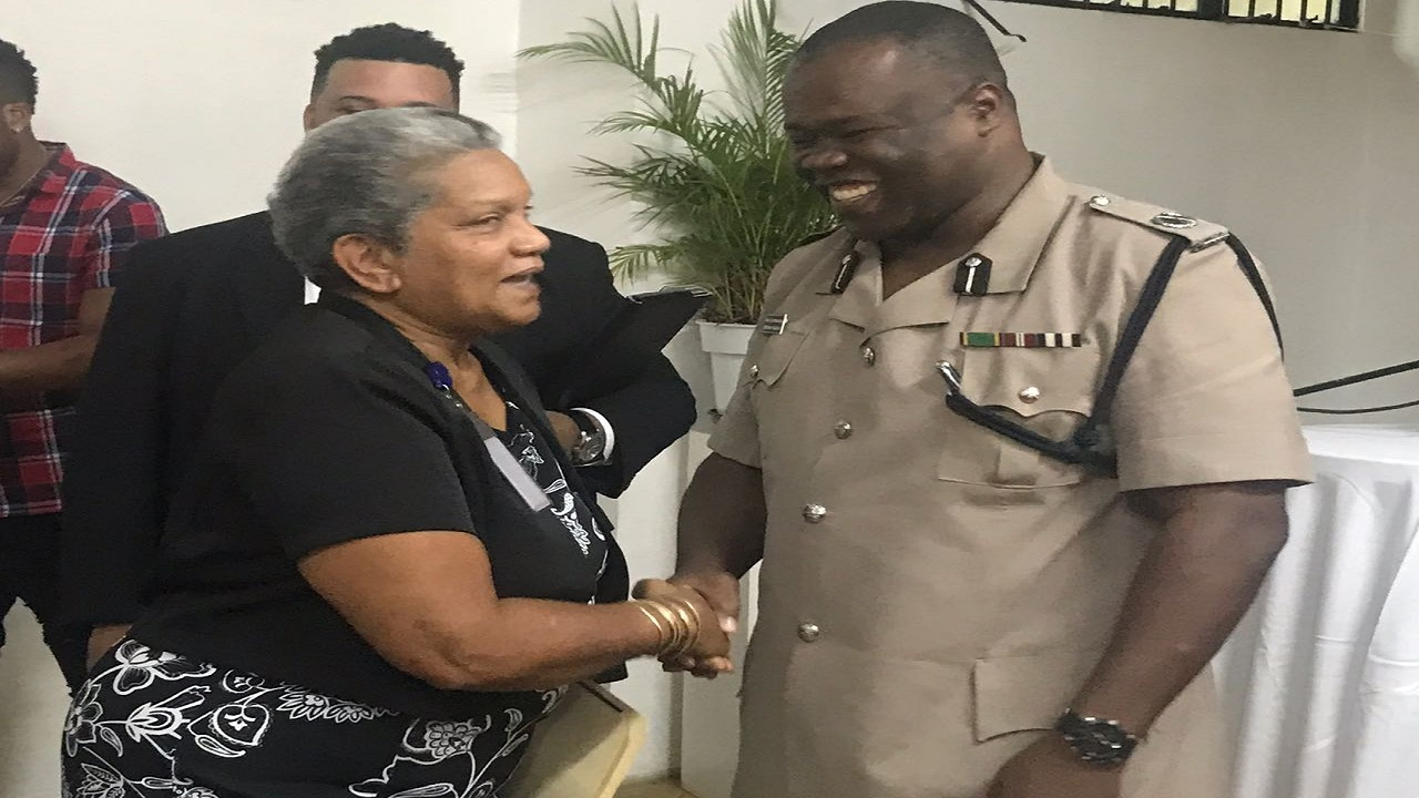 Public Defender, Arlene Harrison-Henry, greets Assistant Commissioner of Police, Donovan Graham, commander of the Area One police network, at the official opening of the Western Regional Office of the Public Defender in Montego Bay, St James on Friday.