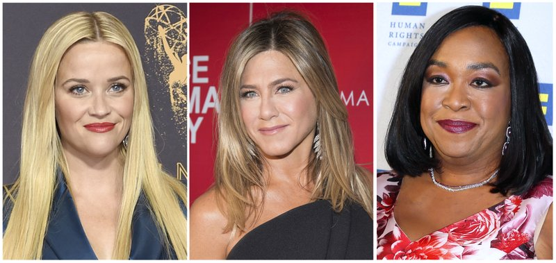 "FILE- This combination of file photos show actresses Reese Witherspoon at the 69th Primetime Emmy Awards in Los Angeles, left, Jennifer Aniston at a screening of ""Office Christmas Party"" in New York and Shonda Rhimes at the 2015 Human Rights Campaign Gala Dinner in Los Angeles. Witherspoon, Rhimes and Aniston are among hundreds of Hollywood women who have formed an anti-harassment coalition called Time's Up. (AP Photo/File)"