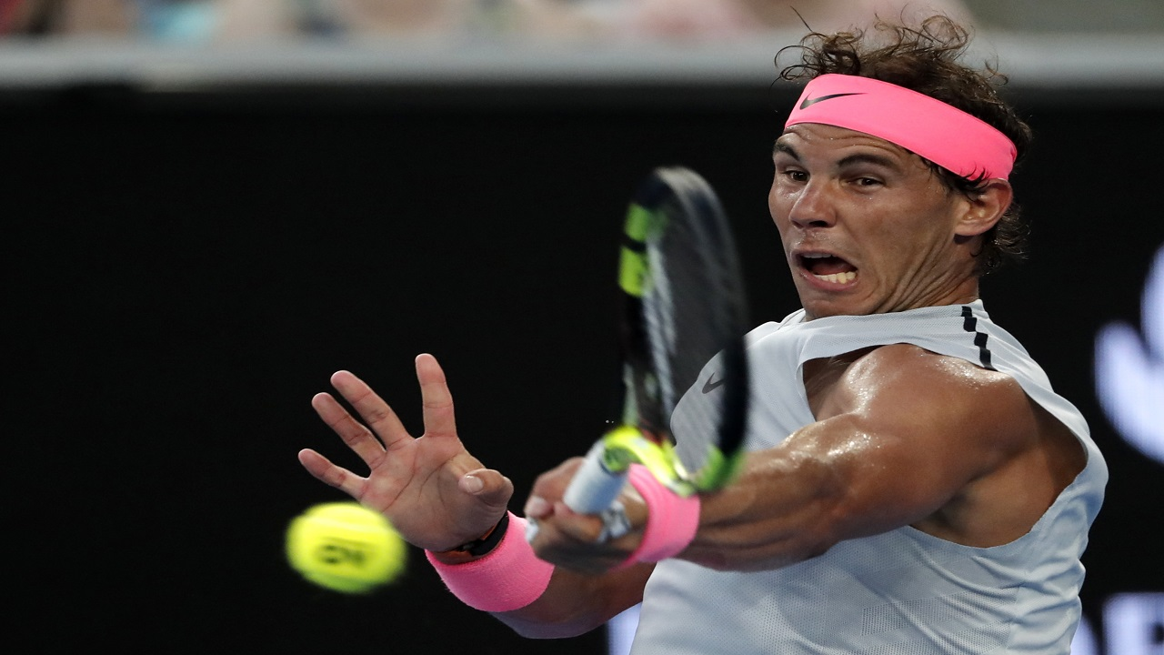 Spain's Rafael Nadal hits a forehand return to Damir Dzumhur of Bosnia and Herzegovina during their third round match at the Australian Open tennis championships in Melbourne, Australia, Friday, Jan. 19, 2018.