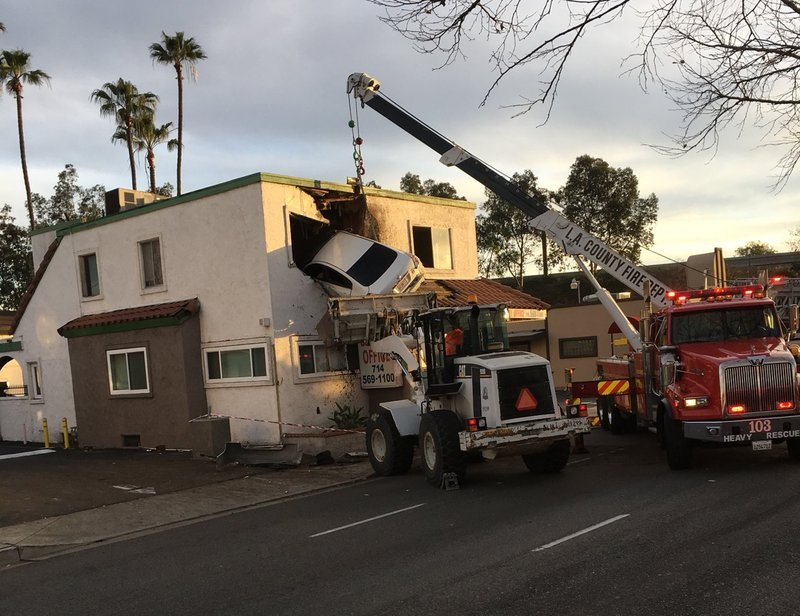 Speeding auto  takes flight, plows into 2nd floor of office building