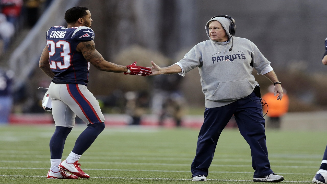 New England Patriots safety, Jamaican-born Patrick Chung (left) is congratulated by coach Bill Belichick during a NFL game. (PHOTO: AP)