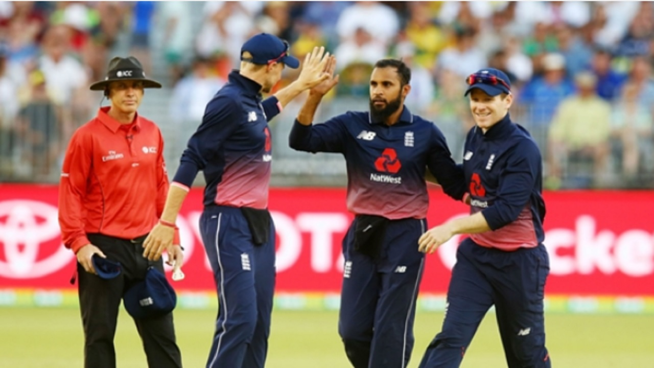 England celebrate the wicket of Marcus Stoinis in Perth.