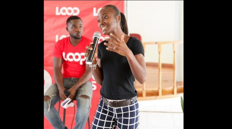 In this file photo, Nutrition Health Coach, Meisha-Gay Mattis addresses the audience during a Loop School Tour event. Seated behind her is Loop News' Kevoy Burton.