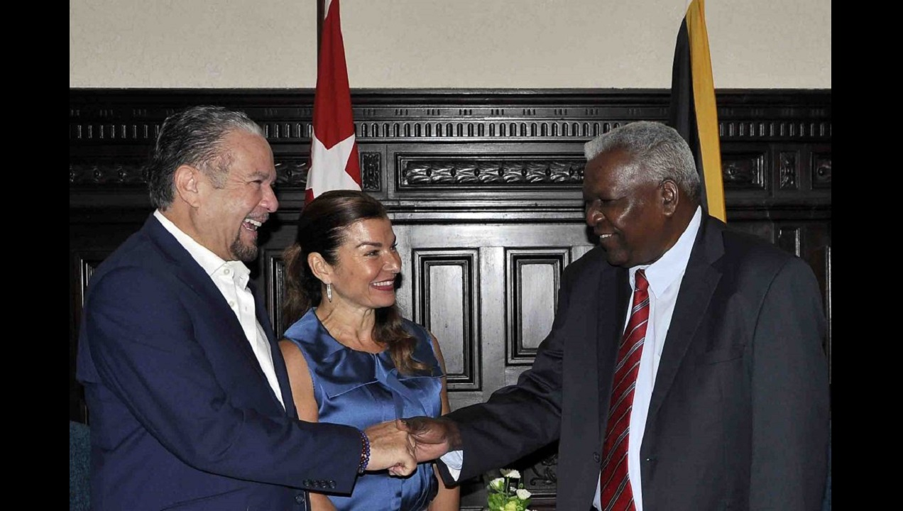 Tom Tavares-Finson (left), president of the Senate of Jamaica, greets Esteban Lazo Hernández while his wife Rose Tavares Finson looks on.