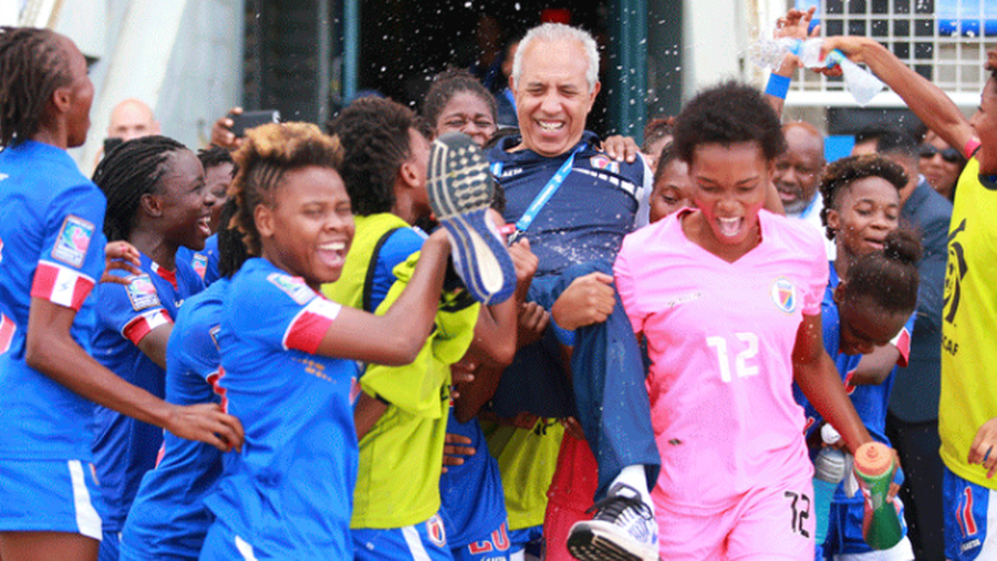 Haiti players lift head coach Marc Collat in celebration after defeating Canada in the CONCACAF U20 Women's match for third place to qualify for the 2018 FIFA U-20 Women's World Cup (Image: CONCACAF)