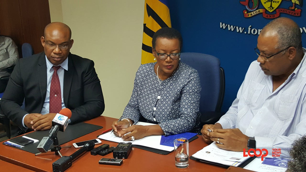 (L-R) General Manager, BWA, Keithroy Halliday; Minister of Foreign Affairs and Foreign Trade, Senator Maxine McClean; and Minister of Health, John Boyce at today's press conference.