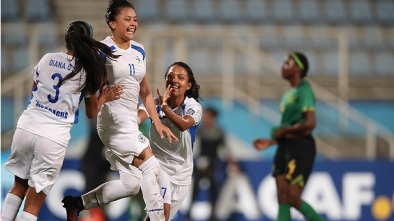 Nicaragua's Yessenia Flores (#11) celebrates with teammates after scoring against Jamaica in the CONCACAF Under-20 Women's Championship on January 23, 2018, in Couva, Trinidad & Tobago.