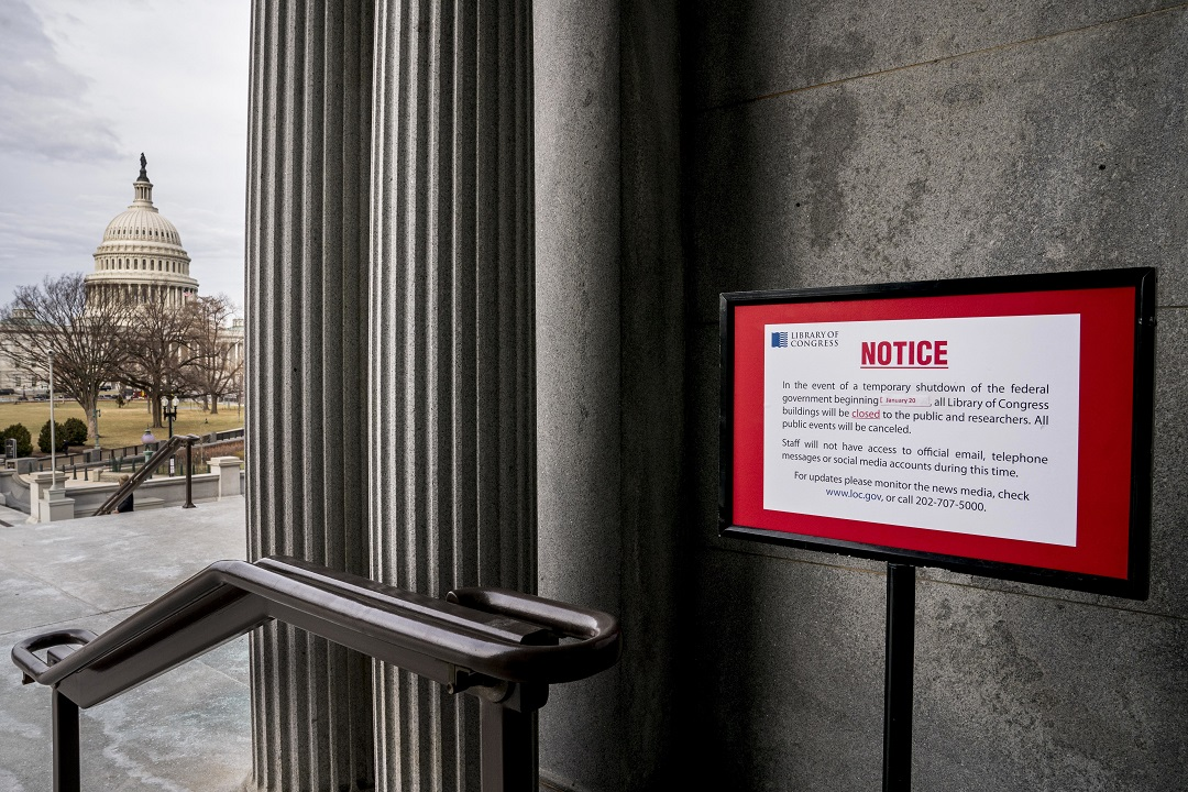 A closure sign posted outside the library of Congress on 22 January 2018