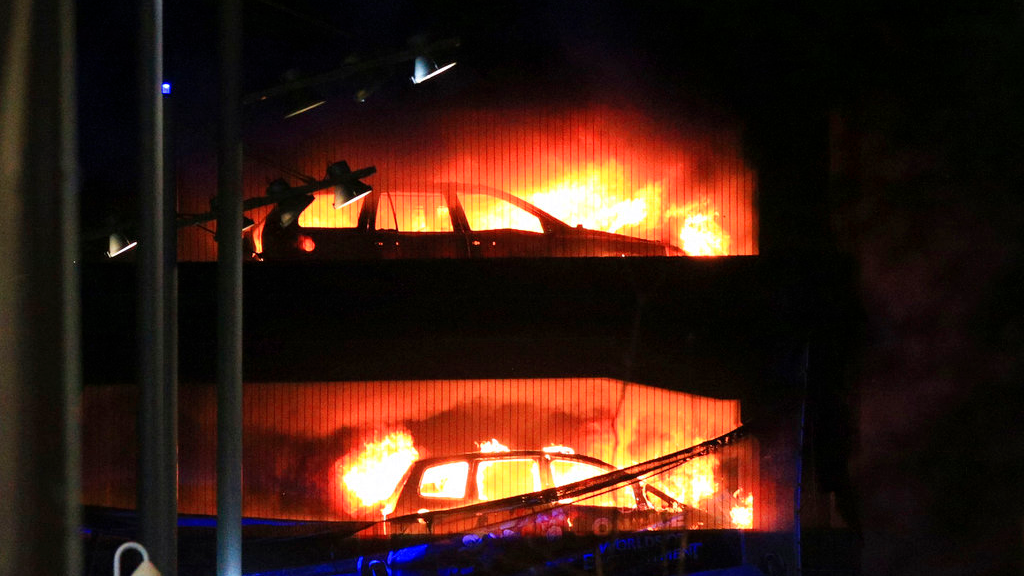 Vehicles burn during a blaze at a multi-storey car park at the Echo Arena on the waterfront in Liverpool, England Sunday, Dec. 31, 2017. (Peter Byrne/PA via AP)