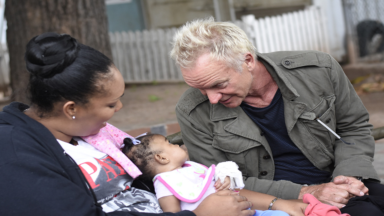 International superstar Sting interacts with baby Daehnell Hylton while her mother, Stephanie McLeish, looks on at the Bustamante Hospital for Children on Friday. (PHOTOS: Marlon Reid)