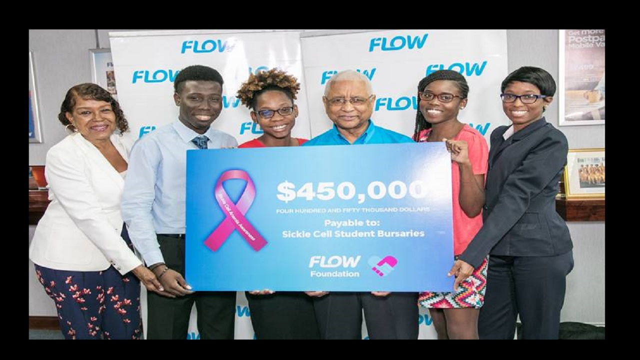 Tertiary students living with sickle cell disease, (L-R) Christine O'Leary, Sanjay Williams, Avia Aiken, Ashleigh Gordon and Sherona Smith smile for the camera after receiving a bursary from Flow Foundation Chairman, Errol Miller (3rd right) during a brief presentation ceremony at Flow's headquarters in Kingston.