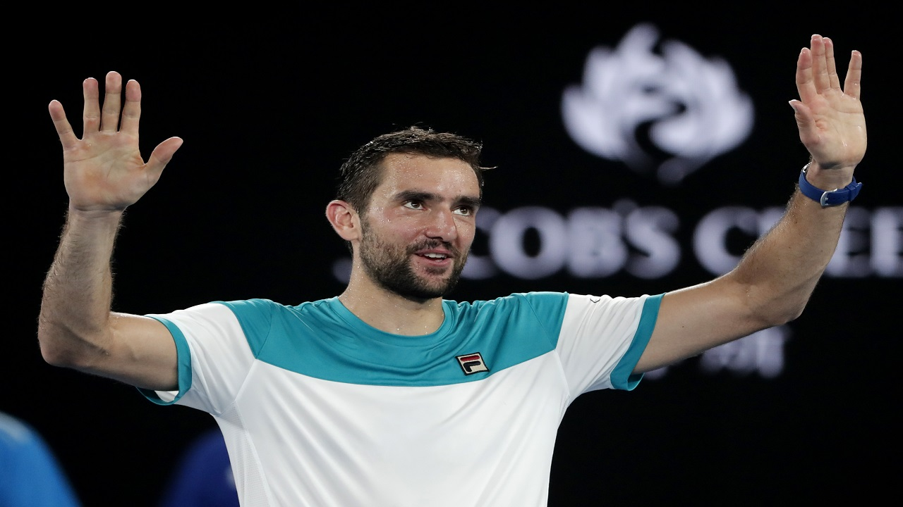 Croatia's Marin Cilic celebrates after defeating Britain's Kyle Edmund in their semifinal at the Australian Open tennis championships in Melbourne, Australia, Thursday, Jan. 25, 2018.