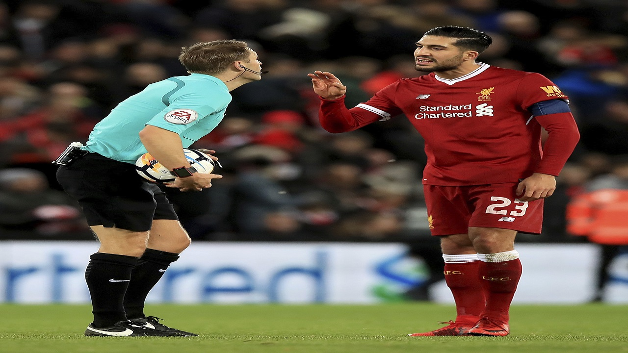 Match referee Craig Pawson, left, speaks with Liverpool's Emre Can during their English FA Cup, fourth round football match against West Bromwich Albion, at the Anfield stadium, Liverpool, England, Saturday Jan. 27, 2018.