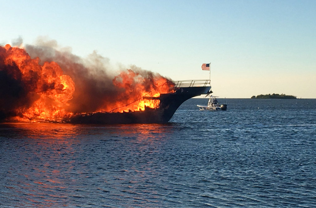 In this photo provided by Pasco County, flames engulf a boat Sunday, in the Tampa Bay area.  (Pasco County Fire Rescue via AP)
