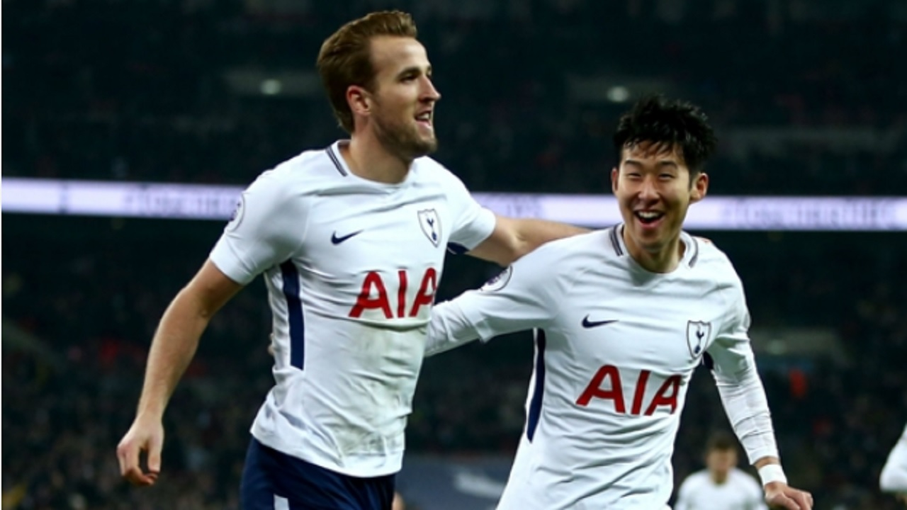 Harry Kane (left) and Son Heung-min celebrate a goal against Everton.