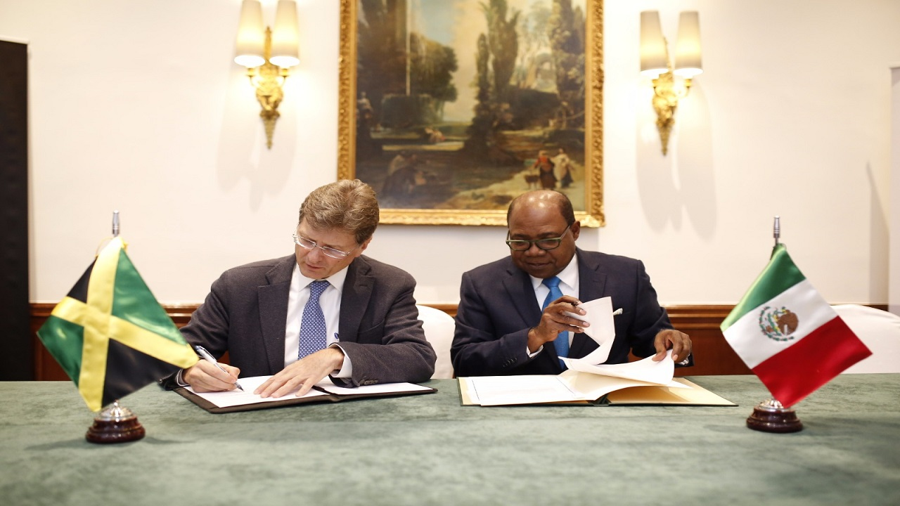 The signing, between Jamaica's Minister of Tourism, Edmund Bartlett and Mexican Secretary of Tourism, His Excellency Enrique de la Madrid Cordero, took place at the Westin Palace Hotel in Madrid, Spain.