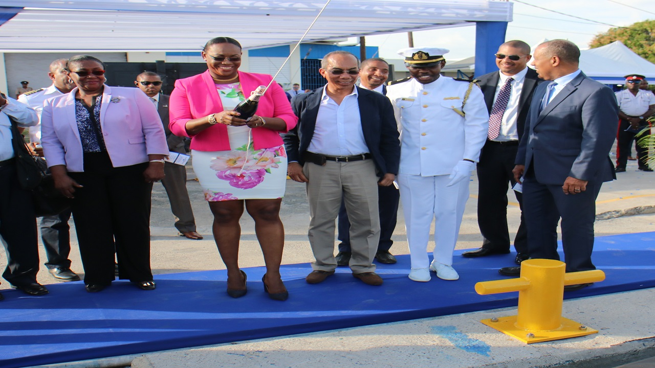 Member of Parliament for East Rural St Andrew Juliet Holness, opens the champagne to christen two new pilot boats. She is flanked by Minister without portfolio in the Ministry of Economic Growth and Job Creation, Dr Horace Chang, Custos for the parish of St. Andrew Dr Patricia Dunwell, President PAJ CEO Professor Gordon Shirley and other PAJ staff.