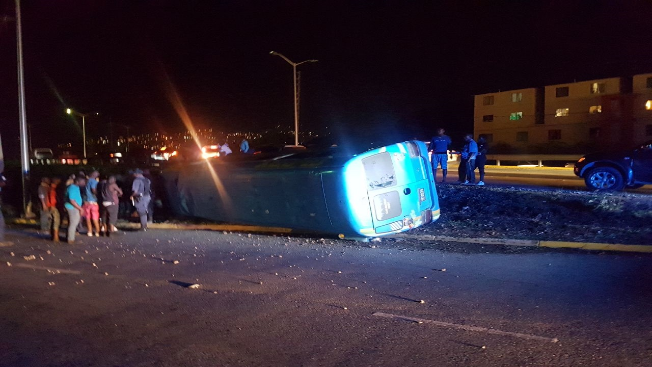 The crash scene along Dunrobin avenue, in the vicinity of Washington Boulevard, on Tuesday night.