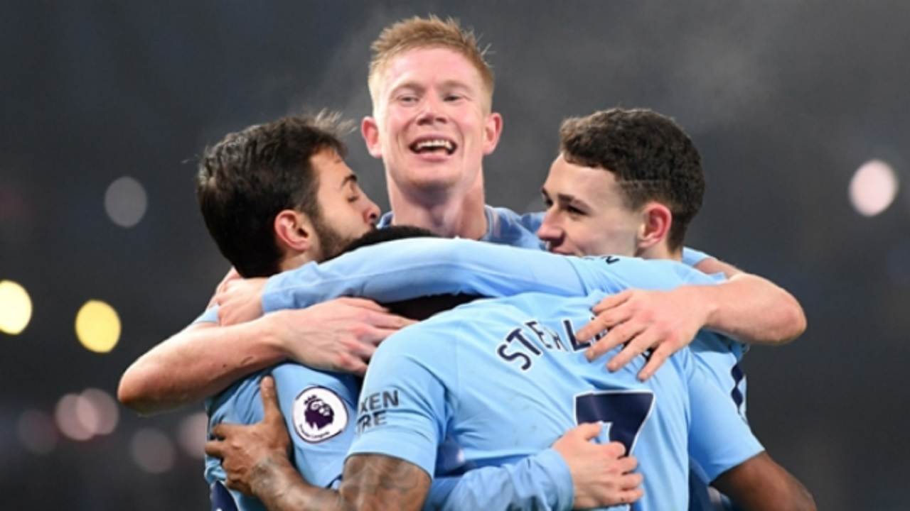 Kevin De Bruyne celebrates with his Manchester City team-mates.